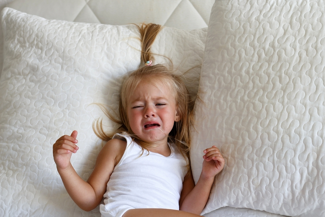 toddler girl in be crying