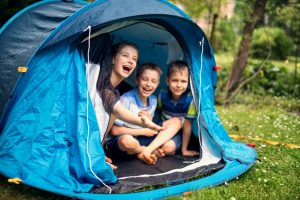 Kids laughing inside a tent