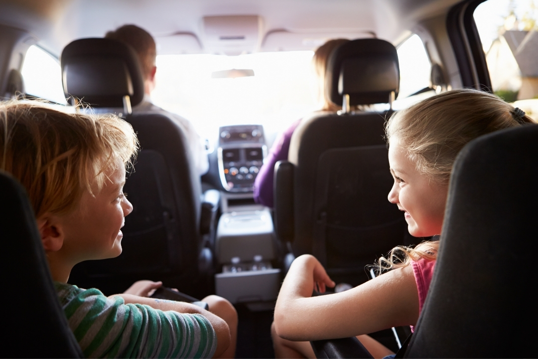 Family listening along to a podcast in car