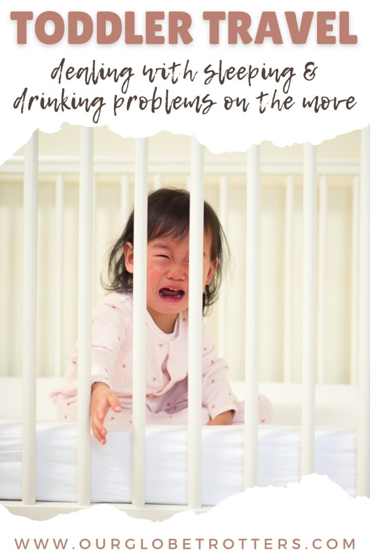 Toddler crying in a cot - toddler travel dealing with sleeping and drinking problems on the move.