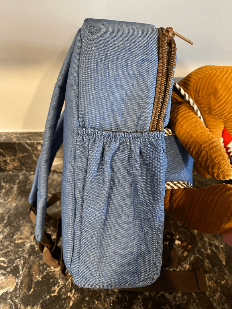 showing the width of a naturally kids toddler backpack
