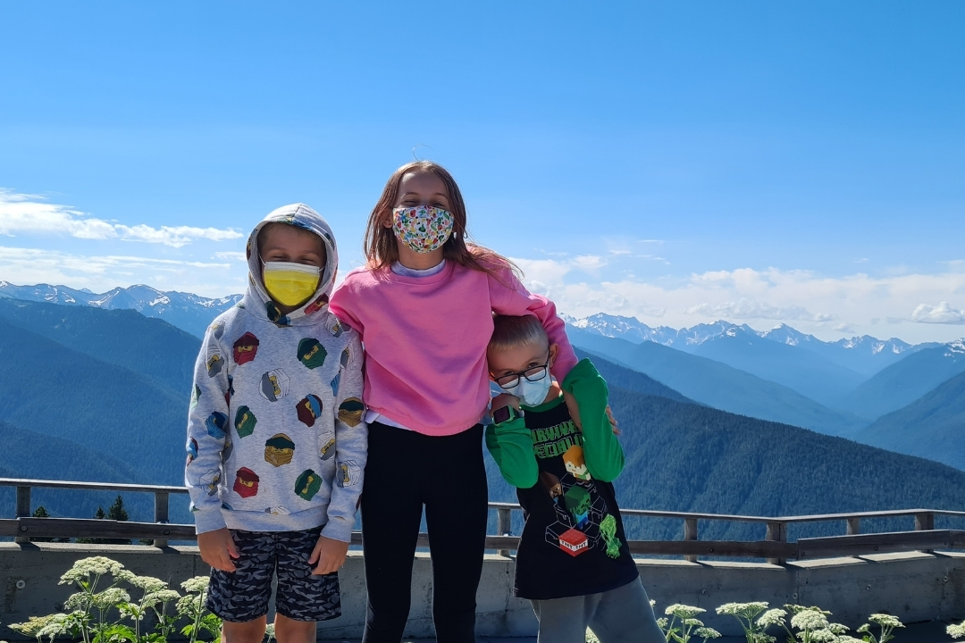 kids on Hurrican Ridge in summer, snow capped mountains