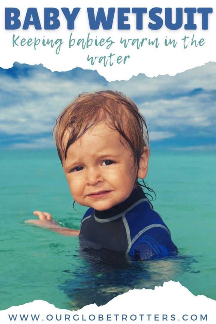 a baby boy in a wetsuit in sea water